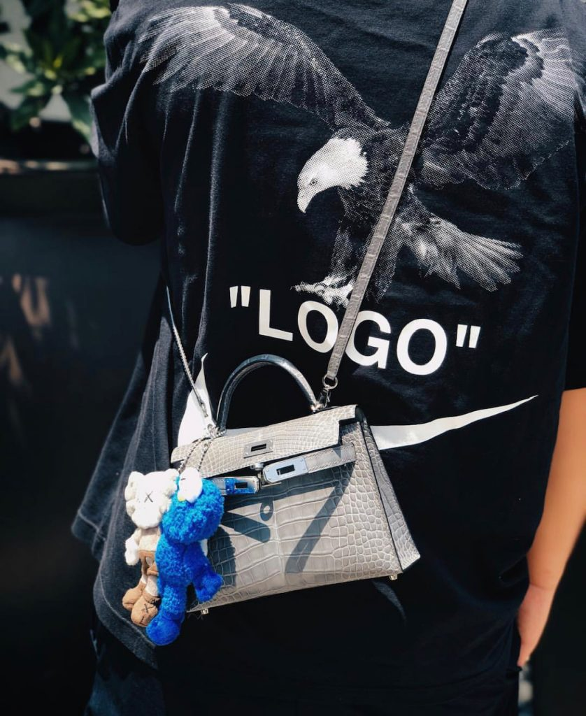 Off White eagle logo T Shirt with Croc Hermes bag and KAWS dolls