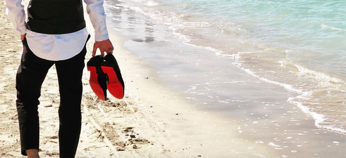 Fine D3sign Christian Louboutin mens shoes sneakers on beach