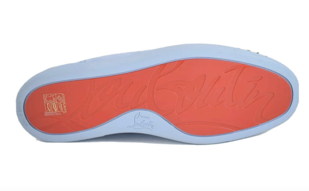 A crisp image of the bottom of a Louboutin sneaker